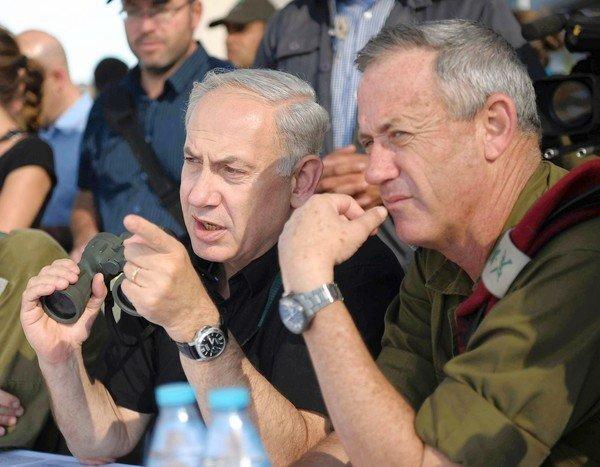 Israeli Prime Minister Benjamin Netanyahu, left, with Defense Forces Chief of Staff Lt. Gen. Benny Gantz, observes an army infantry exercise taking place on the Golan Heights. Netanyahu has been publicly criticizing the Obama administration for refusing to issue a more specific ultimatum to Iran over its nuclear program.