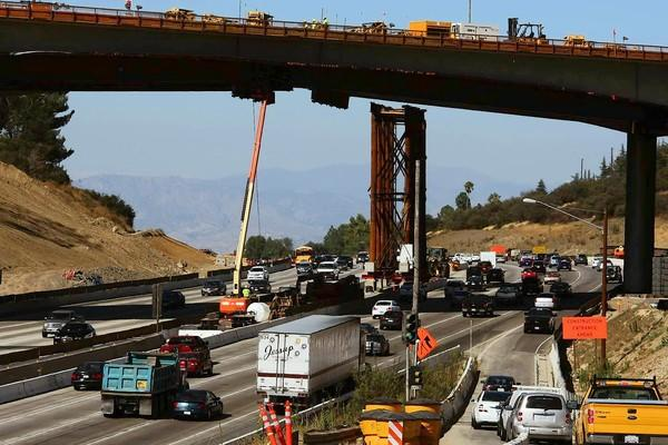 Traffic flows along the 405 Freeway last week amid work on the Mullholland Bridge in Los Angeles. Ten miles of the 405 Freeway will be closed between the 10 and 101 freeways from the evening of Sept. 28 until early morning Oct. 1.