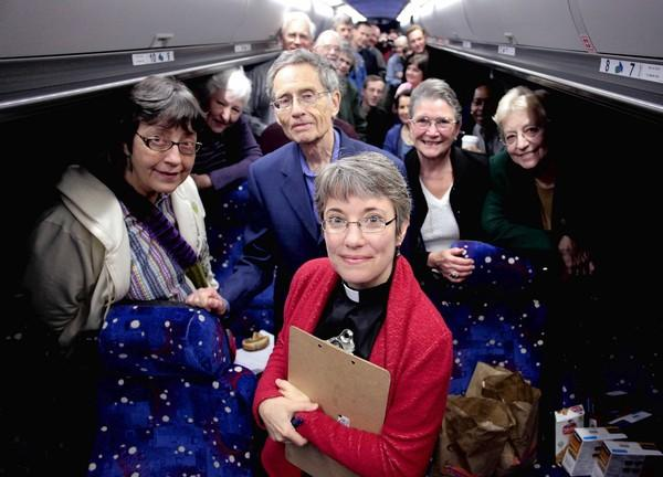 """""""You'll never know which thing you did turned out to be the one that made a difference for someone,"""" says the Rev. Clare Butterfield, center, a Unitarian Universalist minister and executive director of Faith in Place, with a group of 30 people hopping a bus to Springfield to lobby legislators"""