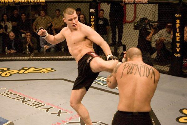 "Michael Bisping, left, competes during ""The Ultimate Fighter"" reality series on Spike TV that catapulted his career in 2006."