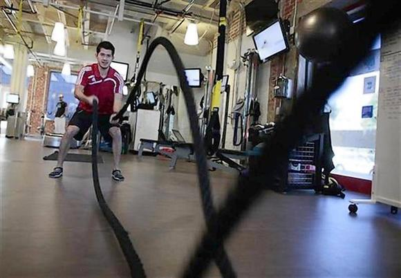 Delgado demonstrates a rope exercise in the company gym at the Google campus near Venice Beach, in Los Angeles