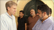 In this photo posted on the Facebook page of the U.S. Embassy in Tripoli, Libya, on Aug. 27, U.S. Ambassador to Libya Christopher Stevens, left, shakes hands with a Libyan man in Tripoli.