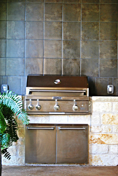 Add a tile counter and backsplash to the grill station.
