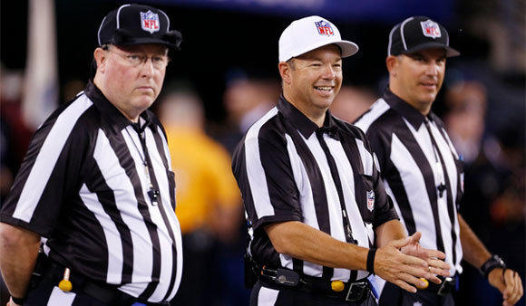 Referee Jim Core, center, stands with fellow replacement officials before the New York Giants-Dallas Cowboys game.