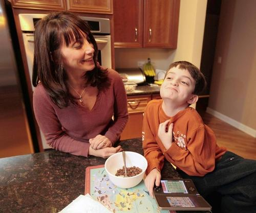 "Cindi Sodolski with son Nate in their Chicago kitchen. Nate, a first-grader, is allergic to nuts, dairy and eggs. ""It was unbelievable to me that they would suggest bringing all those allergens into the classroom,"" she said."
