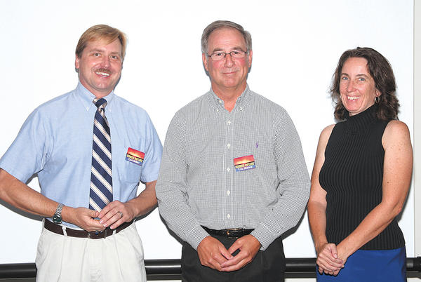 Rotary Club of Hagerstown-Sunrise members who were recognized as Multiple Paul Harris Fellows are, from left, Curt Miller, T.O. Moore and Jeanne Singer. Receiving his second Paul Harris Fellow also is Bill Fritts, who is not pictured. He is in the photo at top right.