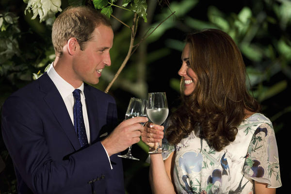 Britain's Prince William and his wife Catherine, the Duchess of Cambridge, make a toast in the honor of Queen Elizabeth's Diamond Jubilee at a British Gala reception at the Eden Hall in Singapore.