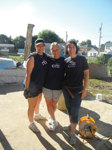 From left, Teresa Stottlemyer, Nita Wright and Kim Jenkins were among a team of 20 volunteers from Citis Hagerstown operations center who recently helped the Women Build and Apostles Build groups of Habitat for Humanity of Washington County work on a two-story duplex on Concord Street.
