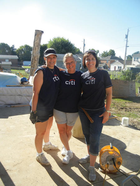 From left, Teresa Stottlemyer, Nita Wright and Kim Jenkins were among a team of 20 volunteers from Citi¿s Hagerstown operations center who recently helped the Women Build and Apostles Build groups of Habitat for Humanity of Washington County work on a two-story duplex on Concord Street.