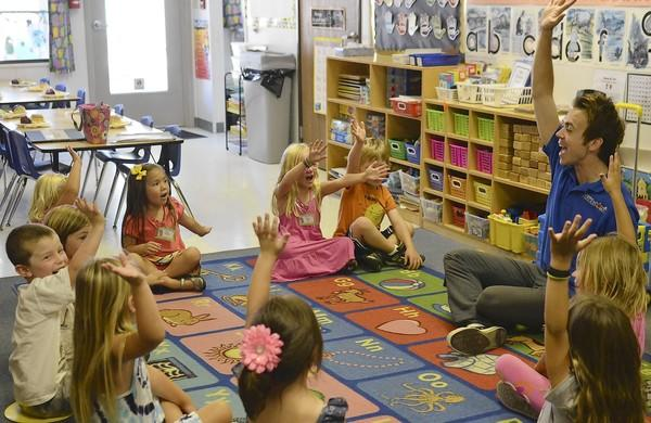 Aaron Bertram of Little RockStars teaches kids about music and rhythm at Patti's Preschool in Huntington Beach on Sept. 7.