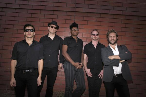 From left, Andy Rosenstein, Ben Taylor, Jayson Brooks, Kevin Marks, and Bily Bungeroth of JC Brooks and the Uptown Sound pose for a portrait outside of Rax Trax studio.