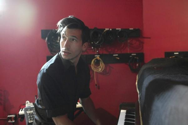 "Andy Rosenstein checks his pitch on a piano before recording background vocals for ""These Things I Know to Be"" at Rax Trax studio."