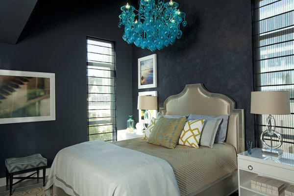 Erinn Valencich designed the master bedroom with blue walls layered in Portola Paints & Glazes' Roman Clay, a finish applied with a putty knife to add texture.