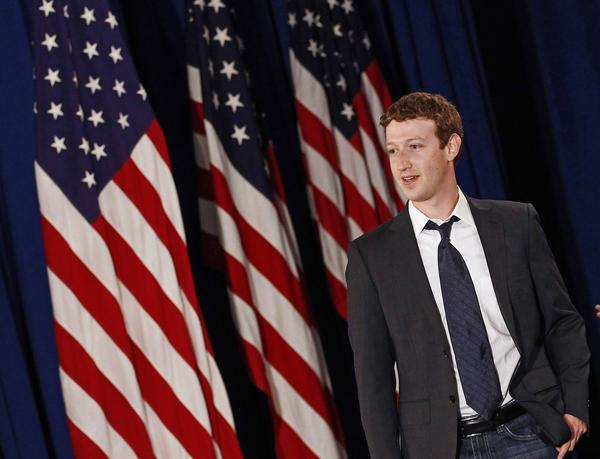 Facebook CEO Mark Zuckerberg arrives for the start of a town hall meeting with U.S. President Barack Obama at Facebook Headquarters in Palo Alto, California April 20, 2011.
