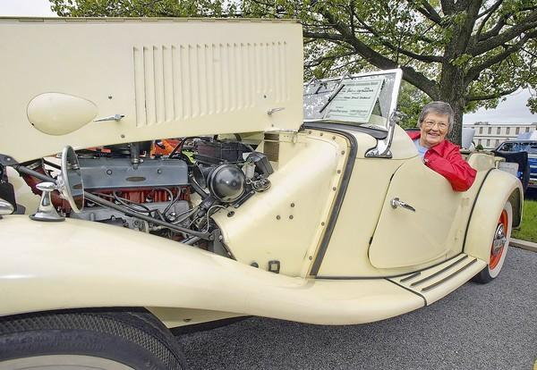 Mary Dawn Dobson, of Laurel, sits behind the wheel of her 1954 MG/TD, at last year's Laurel Lions Club Endless Summer Car Show.
