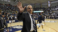STORRS — Jim Calhoun sat in the front row of a near-empty Gampel Pavilion on Wednesday and he watched Kemba Walker, now in the NBA, push the ball up and down the court with the current UConn men's basketball players. Calhoun's legs were crossed, he was smiling.