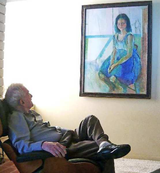 Mario Zamparelli in his La Canada home looking at a portrait he painted of his daughter, Gina Zamparelli.