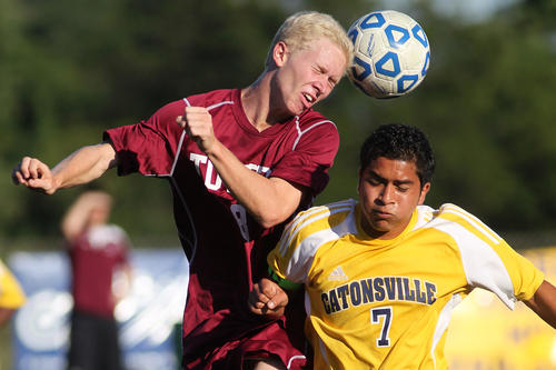 Towson's Garrett Gischel, left, and Catonsville's Jose Moran go up for a header.