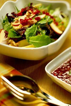 "Pear and apple slices are tossed with a light, bright cranberry vinaigrette in this simple yet flavorful salad. <a href=""http://www.latimes.com/features/food/la-fo-pear,0,7744671.story"">Click here for the recipe.</a>"