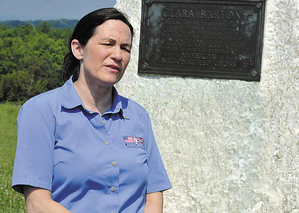 Susan Rosenvold stands at the Clara Barton memorial at Antietam National Battlefield while talking about the efforts of Clara Barton and other women to provide care for the wounded and dying during the Civil War. Rosenvold is superintendent of Clara Barton's Missing Soldiers Office, a satellite of the National Museum of Civil War Medicine in Frederick, Md.