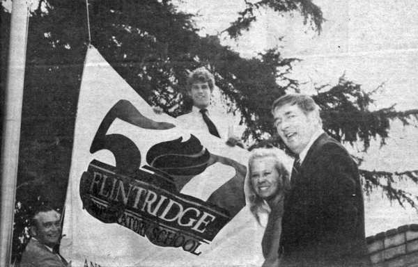 John W. Jorgensen, from left, Bill Clark, Sharon Allen and Edor G. Anderson, headmaster, hoist a banner on the flagpole of Flintridge Preparatory School in September 1982, marking the school's 50th anniversary.