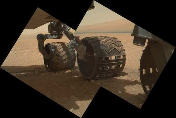 This view of the three left wheels of NASA's Mars rover Curiosity combines two images that were taken by the rover's Mars Hand Lens Imager (MAHLI) during the 34th Martian day, or sol, of Curiosity's work on Mars.