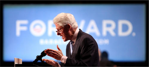 Former president Bill Clinton delivers remarks while appearing on behalf of president Barack Obama, during a rally in Orlando, Fla., Wednesday, September 12, 2012.