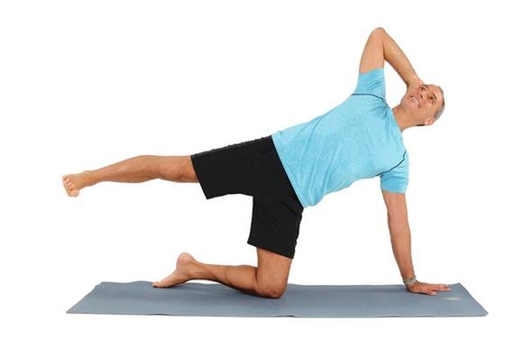 This is a challenging exercise to strengthen the muscles in your abs, arms and legs while simultaneously stretching your abdominals, hips and quadriceps.
