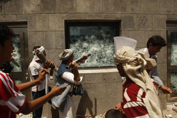 "Yemeni protesters break a window of the U.S. Embassy during a protest about a film ridiculing Islam's Prophet Muhammad, in Sanaa, Yemen, Thursday. Dozens of protesters gather in front of the U.S. Embassy in Sanaa to protest against the American film ""The Innocence of Muslims"" deemed blasphemous and Islamophobic."