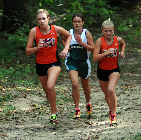 Harbor Springs Kaitlyn Alessi (from left), Boyne Falls Erica Westbrook and Harbor Springs' Jessica Worm climb a hill at the Boyne Valley Lodge Co-Ed Invitational Wednesday near Walloon Lake. The Rams won the invite for an 11th straight year.