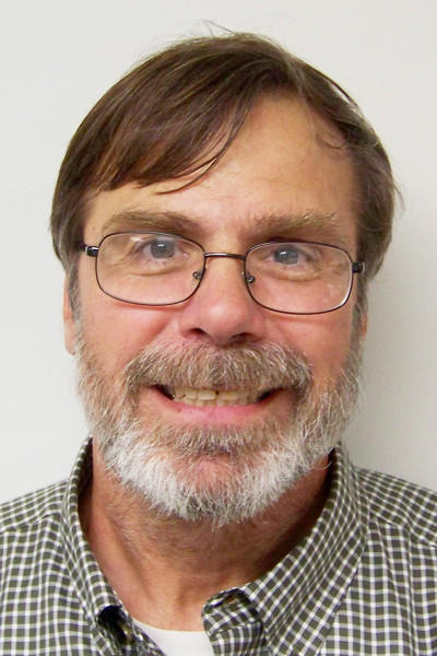 Larry Sullivan will retire at the end of September as the Charlevoix County planning director. The county board of commissioners and planning commission disagree on how to replace the employee.