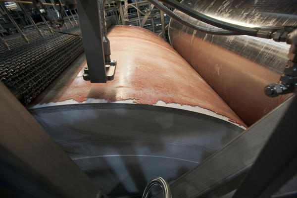 "In this March  file photo, the beef product known as pink slime or lean finely textured beef is frozen on a large drum as part of its manufacturing process at the Beef Products Inc.'s plant in South Sioux City, Neb. Beef Products Inc. plans to file a defamation lawsuit in the wake of a publicity storm over a meat product that critics have dubbed ""pink slime."""