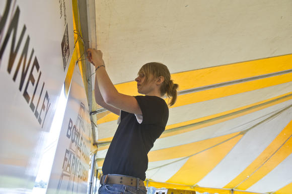 Boyle County High School junior Alyssa Porter works on the tent Wednesday for United Way Day of Action at Millennium Park. Porter was one of the members of the Y club and National Honor Society who helped at the park.