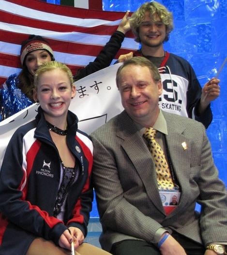 Gracie Gold and her coach, Alex Ouriashev (both foreground), at the World Team Troph