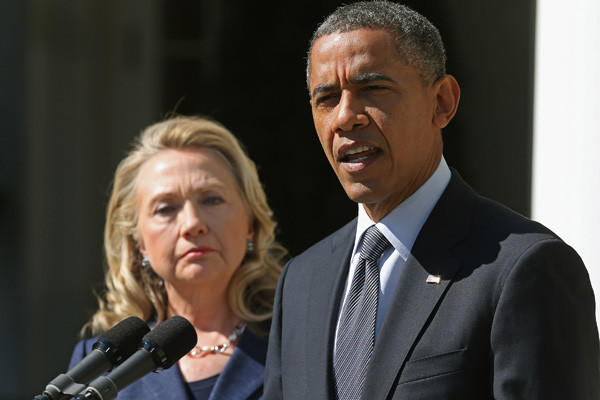 Secretary of State Hilary Clinton stands beside President Obama as they deliver a joint statement regarding the death of U.S. ambassador to Libya J. Christopher Stevens on Sept. 12.