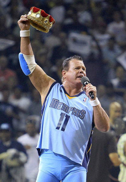 In an April 2011 file photo, Jerry Lawler gestures to fans before the start of Game 3 of a first-round NBA playoff series game between the San Antonio Spurs and the Grizzlies in Memphis, Tenn.