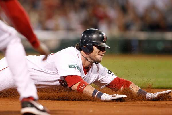 Boston Red Sox catcher Jarrod Saltalamacchia (39) slides into third base for a triple against the New York Yankees during the fifth inning at Fenway Park.