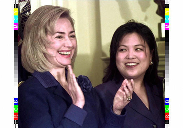 First Lady Hillary Clinton with women's rights activist Julie Su on Dec. 10, 1996.