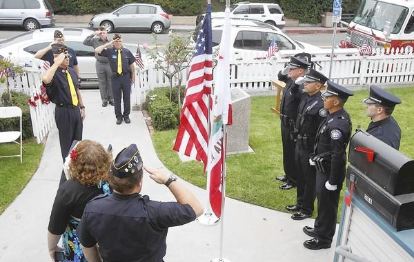 Members of the Laguna Beach Police Department Color Guard salute the flag in honor of those lost on Sept. 11, 2001, during the Patriot Day ceremony and 9/11 rememberance at Legion Hall on Tuesday.