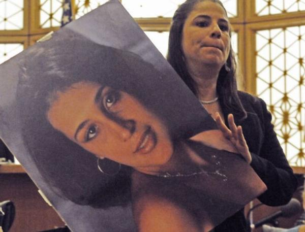 Assistant State Attorney Christine Zahralban holds a photo of Ana Maria Angel during the trial of Joel Lebron Sept. 12, 2012. (Marice Cohn Band)