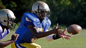 Everything 'perfect' so far for Smithfield quarterback Jermaal Wells
