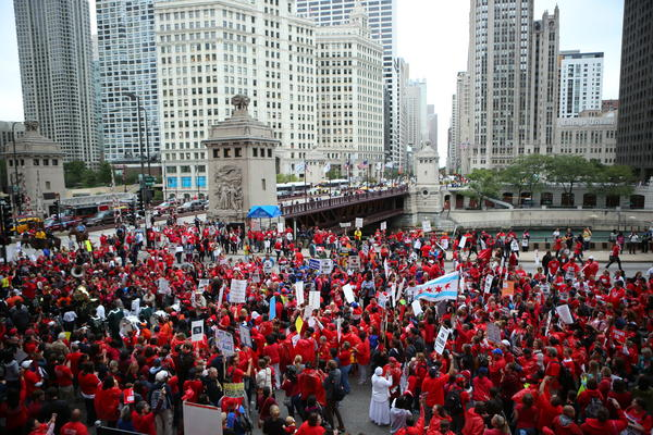 Chicago Teachers Union members and supporters rally at the corner of Michigan Avenue and Wacker Drive in downtown Chicago.