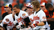 Manny Machado's 14th-inning single clinches the Orioles' first non-losing season since 1997
