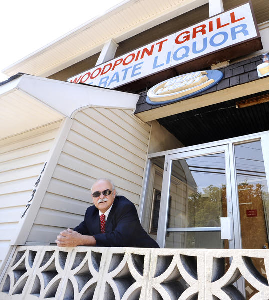 Realtor Tim Light stands on the front porch at Woodpoint Bar & Grill that is being renovated.   The owners would like for prospective new owners to be able to reopen the business.
