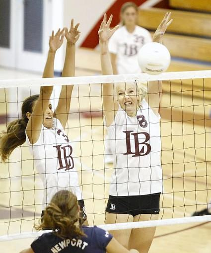 Laguna's Cammie Dorn, left, and Sami Harting, block a shot at the net during Tuesday's match against Newport Harbor.