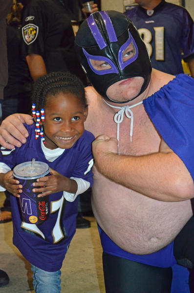 Neal Moorhouse, aka Carne Cabeza, mugs with a fellow fan at the Ravens-Bengals game Sept. 10 at M&T Bank Stadium.