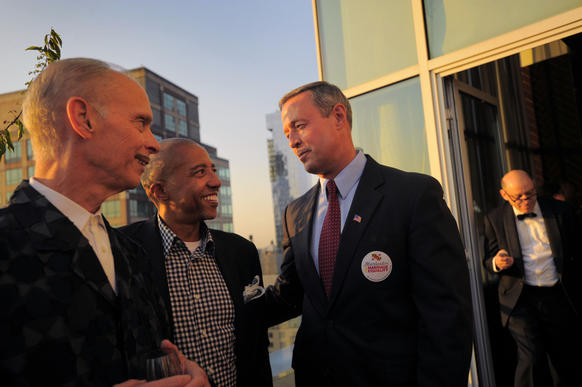 Native Marylander and filmmaker John Waters, Kevin Liles, entertainment business executive, and Maryland Gov. Martin O'Malley gather together during a fundraiser for marriage equality at Jimmy's, atop the James Hotel in downtown Manhattan