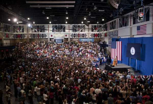 First Lady Michelle Obama campaigns for her husband's reelection at the University of Mary Washington in Fredericksburg, Va. A new NBC/Wall St. Journal/Marist University poll shows the president leading Mitt Romney in Virginia, 49% to 44%.