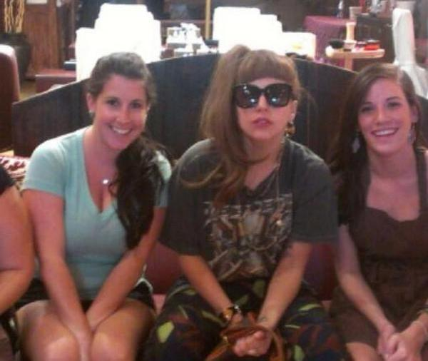 Pop star Lady Gaga (center) poses with staff at Mojo Spa in Wicker Park September 12, 2012.