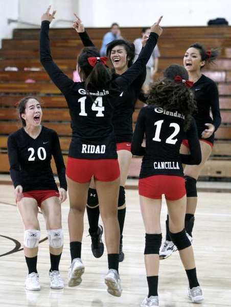 The Glendale High School girls' volleyball team celebrates their win over rival Crescenta Valley.